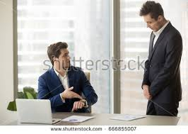 male subordinate receiving reprimand boss being stock photo
