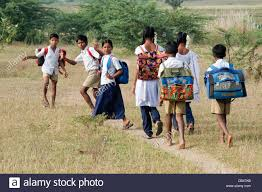 indian children walking to in the countryside andhra