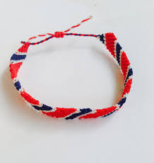 thin handmade bracelet with norwegian flag on it