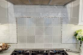 kitchen range hood backsplash cararra marble subway tile pratt