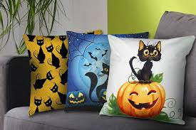 throw these cats on your couch for some scary halloween decorating