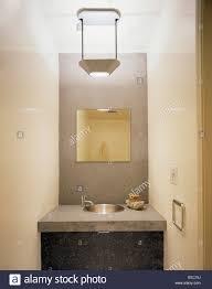 Concrete Vanity Mirror In Concrete Splash Back Above Concrete Vanity Unit With