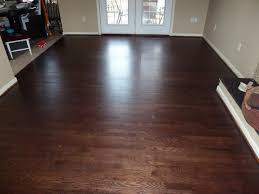 white oak floor sanded water popped and stained with mahogany