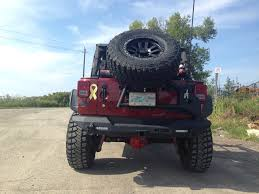jeep rear bumper with tire carrier look at an ace rear bumper is it solid any rattles negatives