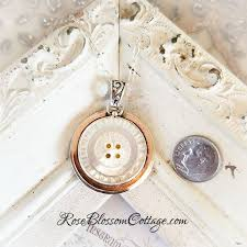 antique necklace pendants images Antique mother of pearl button bronze and sterling pendant necklace jpg