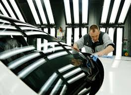 rolls royce factory employee darren lowarson give a rolls royce ghost its final finish