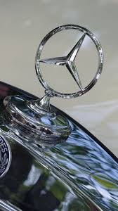 logo mercedes benz wallpaper wallpapers mercedes benz logo emblem hood cars closeup 1440x2560