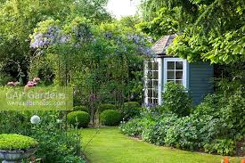 Summer House In Garden - gap gardens bullocks horn cottage feature by mark bolton gap