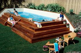 above ground lap pool with stairs and low fence in the backyard