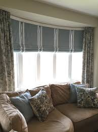 i am often asked how to dress a bow window here is a great option i am often asked how to dress a bow window here is a great option custom roman blinds with batons to help support the length and shape and side panels to