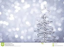 modern christmas detail of metallic modern christmas tree on wood table royalty