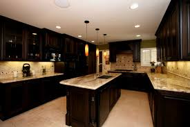 presidential kitchen cabinet glass countertops dark wood cabinets kitchen lighting flooring