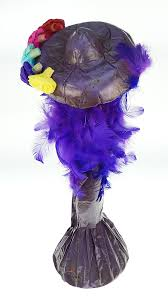 purple feather catrina in purple feather boa made in mexico for celebration