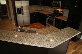 venetian gold light granite venetian gold light granite against dark cabinetry delightful