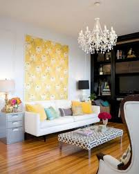elegant crystal chandelier with yellow wallpaper for latest colour