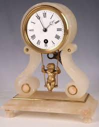 Metal Mantel Clock A Late 19th Century French Alabaster Mantel Clock With Swinging