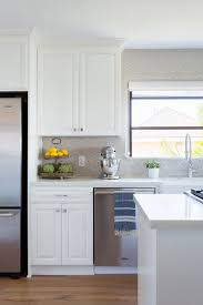 white kitchen cabinets with taupe backsplash taupe backsplash tiles in white kitchen transitional kitchen
