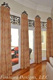 best 25 transom window treatments ideas on pinterest diy beautiful bay window treatment includes tableaux faux iron in the transoms with stationary drapery panels on wrought iron brackets