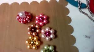 handmade bead flowers angels and way to many stick pins thanks