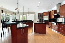 light cherry kitchen cabinets and granite remodeled by home