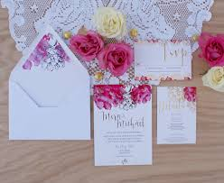 gold foil wedding invitation with pink watercolor flowers
