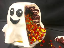 how to make a candy filled ghost cake for halloween genius kitchen