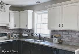 white kitchen cabinets and dark flooring enchanting home design