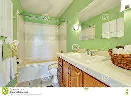light green bathroom interior with white tile trim stock photo