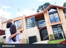 couple looking beautiful house buy stock photo 114620170