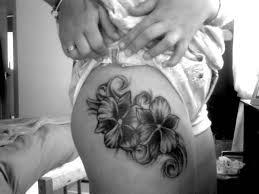 fabulous black and white feminine flower on thigh