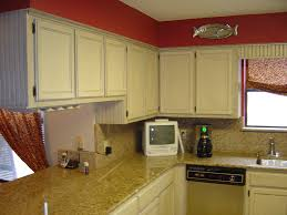 Painting Kitchen Cabinets White Without Sanding by In Demand Red Wall Painted Feat White Marble Countertops As Well