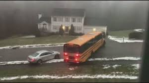 bus filled with students slides down icy street crashes