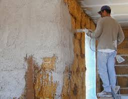 lime plastering of straw bale walls both hand applied and