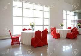 Fine Dining Table Set Up by Gorgeous Red Chairs And White Table Setting For Fine Dining Stock