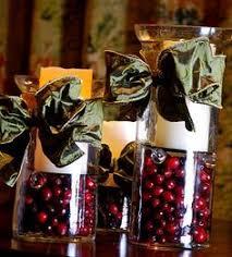 Christmas Hurricane Centerpiece - christmas centerpiece cut limes cranberries and plastic wrap