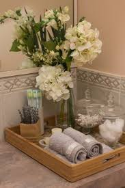 accessorize a bathroom from cluttered mess to pleasantly less