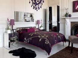 black bed with purple pattern bedding bed and white purple bedside