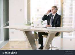 young handsome businessman working laptop desk stock photo