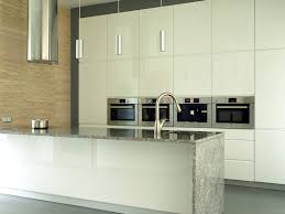 kitchen white wall cabinet waterfall countertop design benchtop