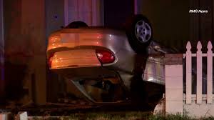 woman killed after vehicle overturns lands on top of her in