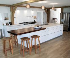 white bulthaup b1 kitchen with white aga oven exposed beams and