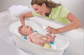 Bathing A Baby In A Bathtub Summer Infant Newborn To Toddler Bath And Shower Center
