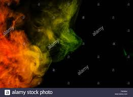 halloween black background image abstract art colorful red and green smoke hookah on a black stock