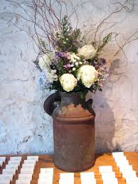 halloween floral centerpieces old milk can different flowers cute idea though could be at