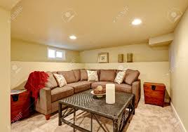 Cozy Family Room With Brown Comfortable Sofa And Wicker Table - Comfortable family room