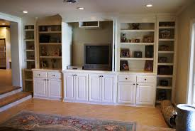 built in entertainment center using kitchen cabinets bar cabinet
