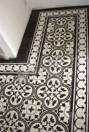 black and white patterned floor tiles clymbers
