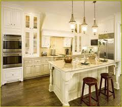 pictures of kitchens with antique white cabinets antique white kitchen cabinets with dark floors home design ideas