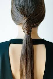 coolest girl hairstyles ever low wrap ponytail the coolest ponytail hairstyles ever photos