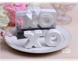 salt and pepper wedding favors hugs and kisses ceramic xo shaped salt and pepper shakers favor
